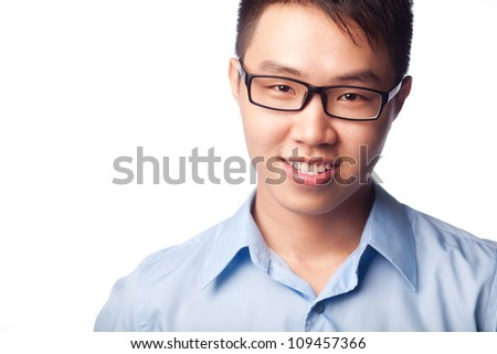 Portrait of young positive businessman looking at camera over white background - stock photo