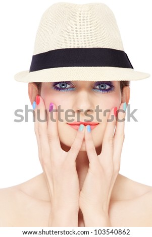 Portrait of young pretty girl in vintage hat, with bright make-up and colorful nail polish, on white background - stock photo
