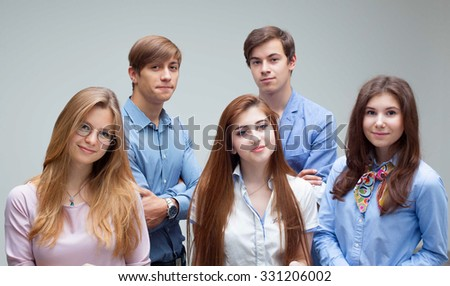 Portrait of young pretty smiling students - stock photo