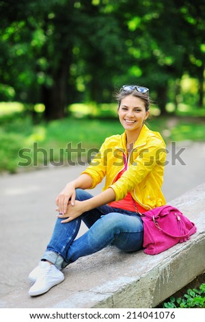 Portrait of young pretty woman in summer - stock photo