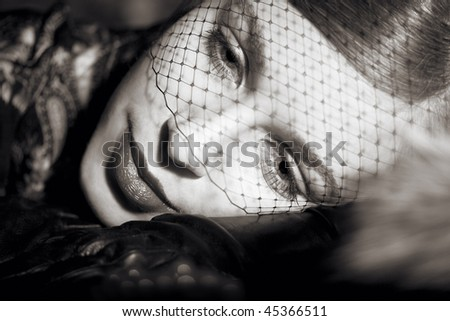 Portrait of young retro woman at  veil - stock photo