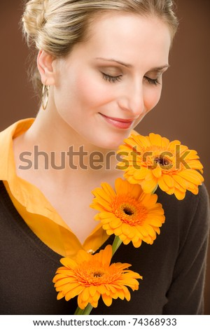 Portrait of young romantic woman hold flower gerbera daisy