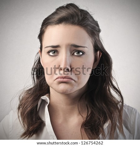 portrait of young sad woman - stock photo