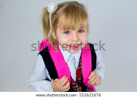 portrait of young schoolgirl with pink schoolbag. isolated on white background