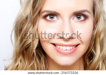 Portrait of young sensual blond woman. Studio shot. - stock photo