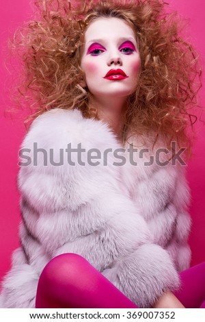 Portrait of young sensual woman with curly hair and fashion clown make-up. Fashin Clown. - stock photo