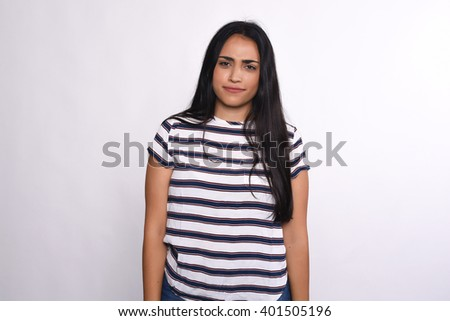 Portrait of young serious woman. Isolated white background - stock photo