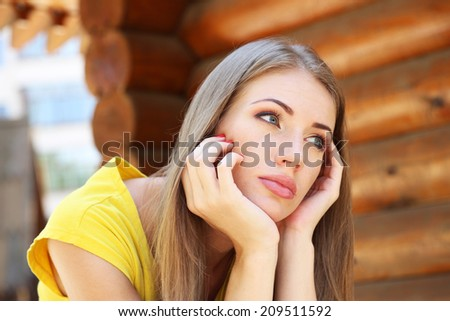 Portrait of young serious woman outdoors - stock photo