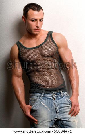 Portrait of young sexy man with muscular body. - stock photo