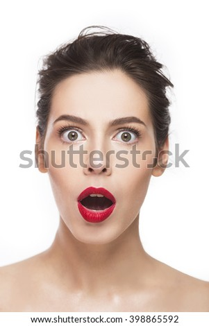 Portrait of young, sexy, shocked girl with red lips over white background. Isolated