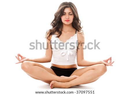 portrait of young sexy woman in meditation pose dressed in underwear isolated on white
