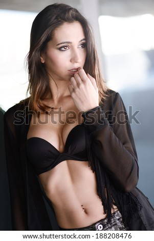 Portrait of young sexy woman, model of fashion, wearing black bra - stock photo