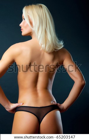 Portrait of young sexy woman on black background - stock photo
