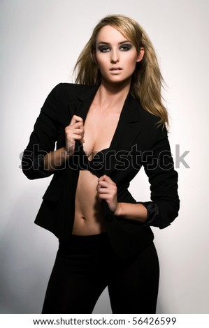 Portrait of young sexy woman on grey background. - stock photo