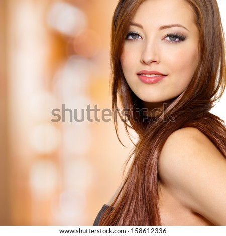 Portrait of young sexy woman with long straight hair - studio - stock photo