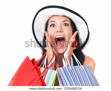 Portrait of young shopaholic woman with many shopping bags, isolated on white background - stock photo