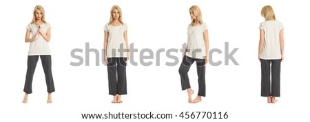 Portrait of young slim woman in pants posing isolated on white background