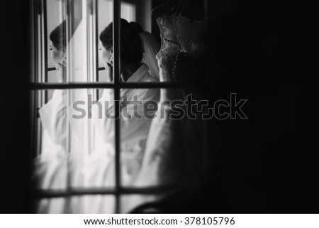 Portrait of young smiling brunette  bride in hotel room