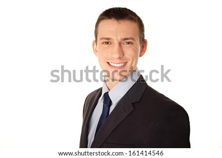 Portrait of young smiling businessman at a suit.