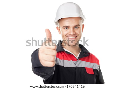 Portrait of young smiling engineer with thumb up isolated on white background - stock photo
