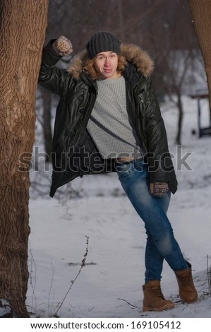 Portrait of young smiling man in the Park at winter - stock photo