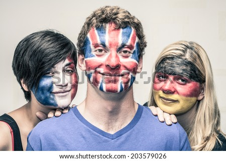 Portrait of young smiling people with painted European flags on their faces. - stock photo