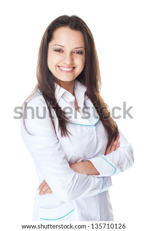 Portrait of young smiling woman doctor with arms crossed isolated on white background - stock photo