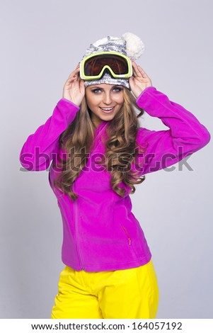 Portrait of young smiling woman in warm clothes  - stock photo