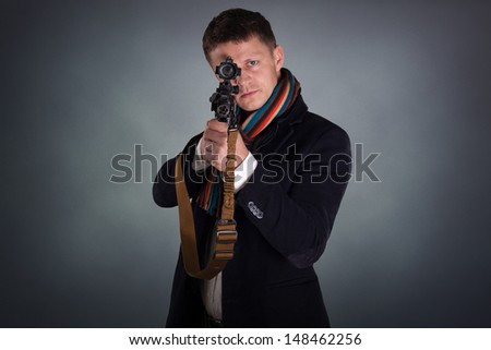 portrait of young soldier pointing with rifle  - stock photo