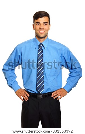 Portrait of young standing businessman in blue shirt - stock photo