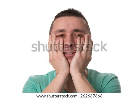 Portrait Of Young Stressed Caucasian Man Covers His Face With Hands Isolated On White Background - stock photo