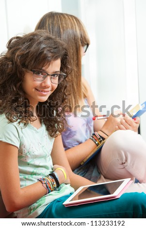 Portrait of young student sitting with digital tablet. - stock photo