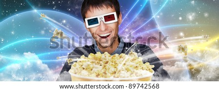 Portrait of young stylish modern man wearing 3d glasses watching 3d movie against cosmic futuristic background and eating exploding popcorn.