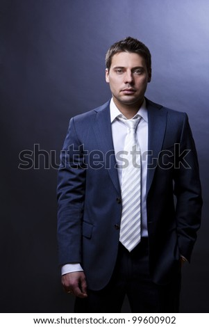 Portrait of young successful businessman
