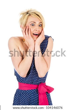 Portrait of young surprised girl holding her face and smiling. isolated on white background - stock photo