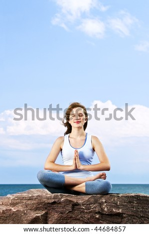 Portrait of young teenage girl practicing yoga outside