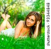 Portrait of young teenage girl relaxing in spring park - stock photo