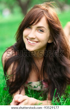 Portrait of young teenage girl relaxing in spring park