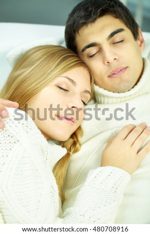 Portrait of young tender couple resting together