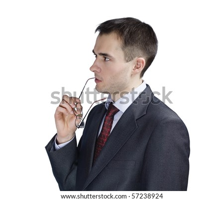 portrait of young thoughtful businessman in glasses - stock photo