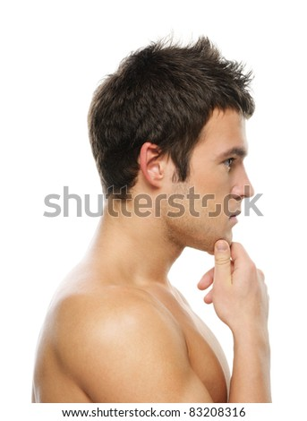 Portrait of young thoughtful man against white background. - stock photo