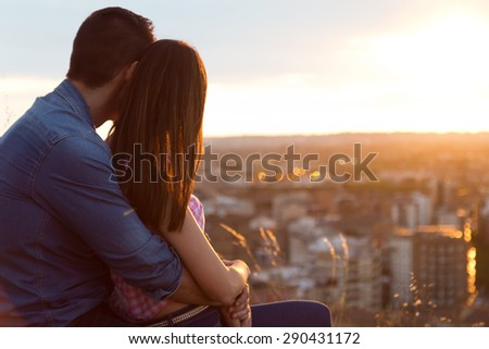 Portrait of young tourist couple looking at the views in the city. - stock photo