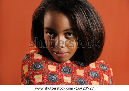 Portrait of young trendy african girl with intense look - stock photo