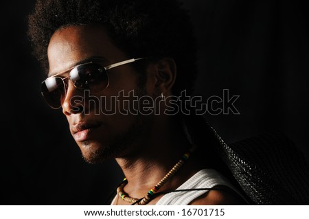 Portrait of young trendy african male with sunglasses - stock photo