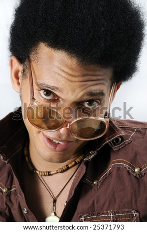 Portrait of young trendy african man with retro sunglasses - stock photo