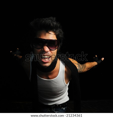 Portrait of young trendy fashion male model screaming - stock photo