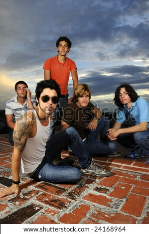 Portrait of young trendy group of friends posing with attitude - stock photo
