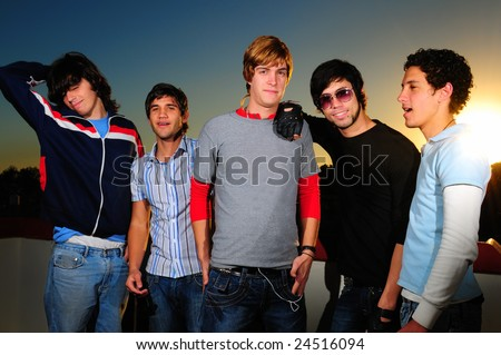 Portrait of young trendy group of friends standing together - stock photo