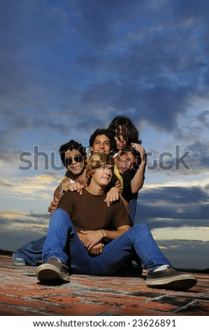 Portrait of young trendy group of male friends having fun - stock photo