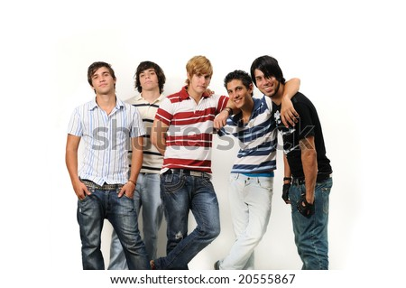 Portrait of young trendy group of male friends posing isolated - stock photo